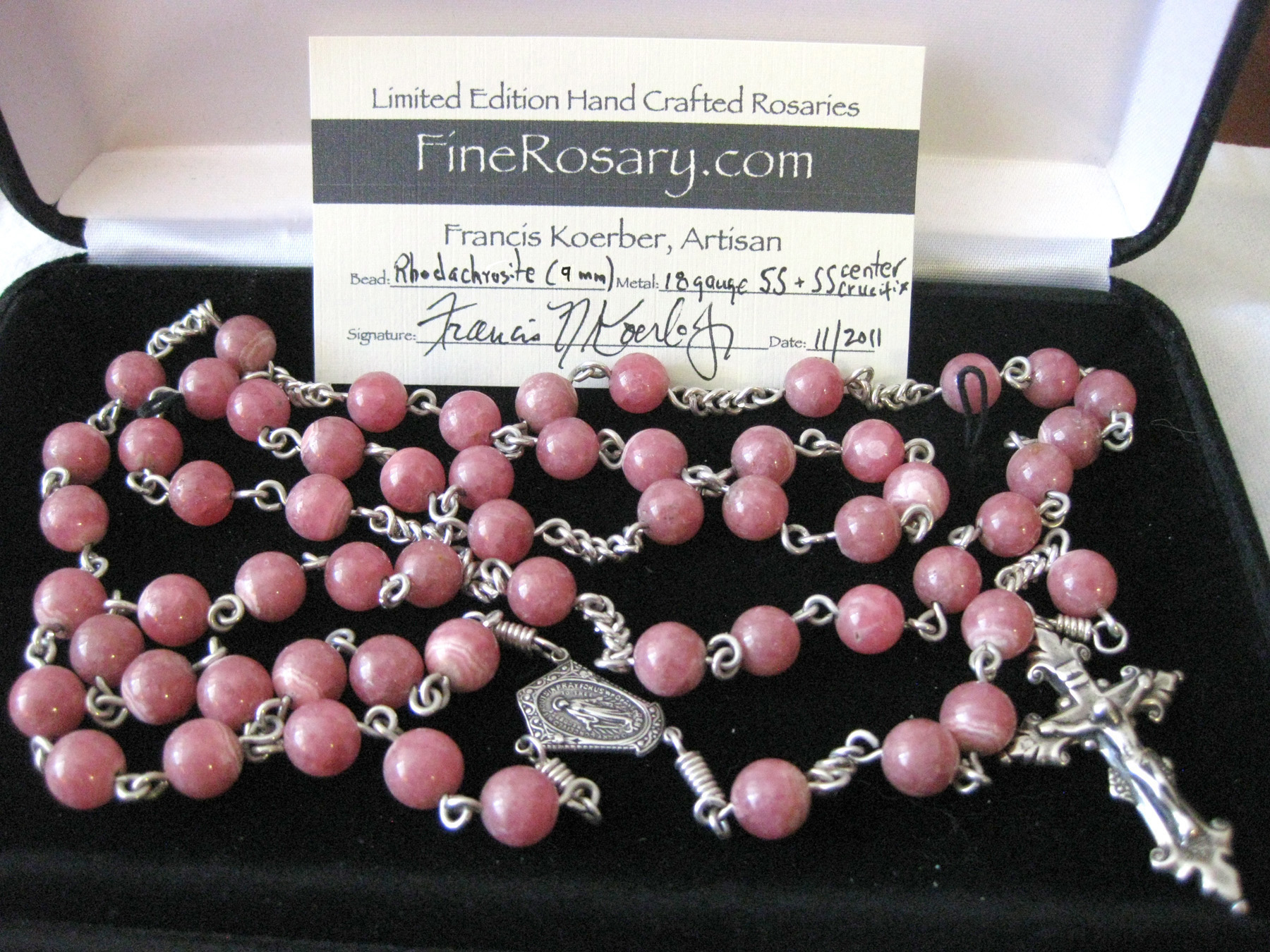 Rhodochrosite Rosary, handmade sterling silver chain, bows and eyelets and hand cast sterling parts by Francis Koerber.